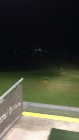 Driving range with a view of the city